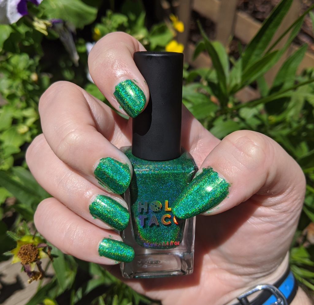 My right hand nails painted with a green lacquer with yellow and green holo sparkles.