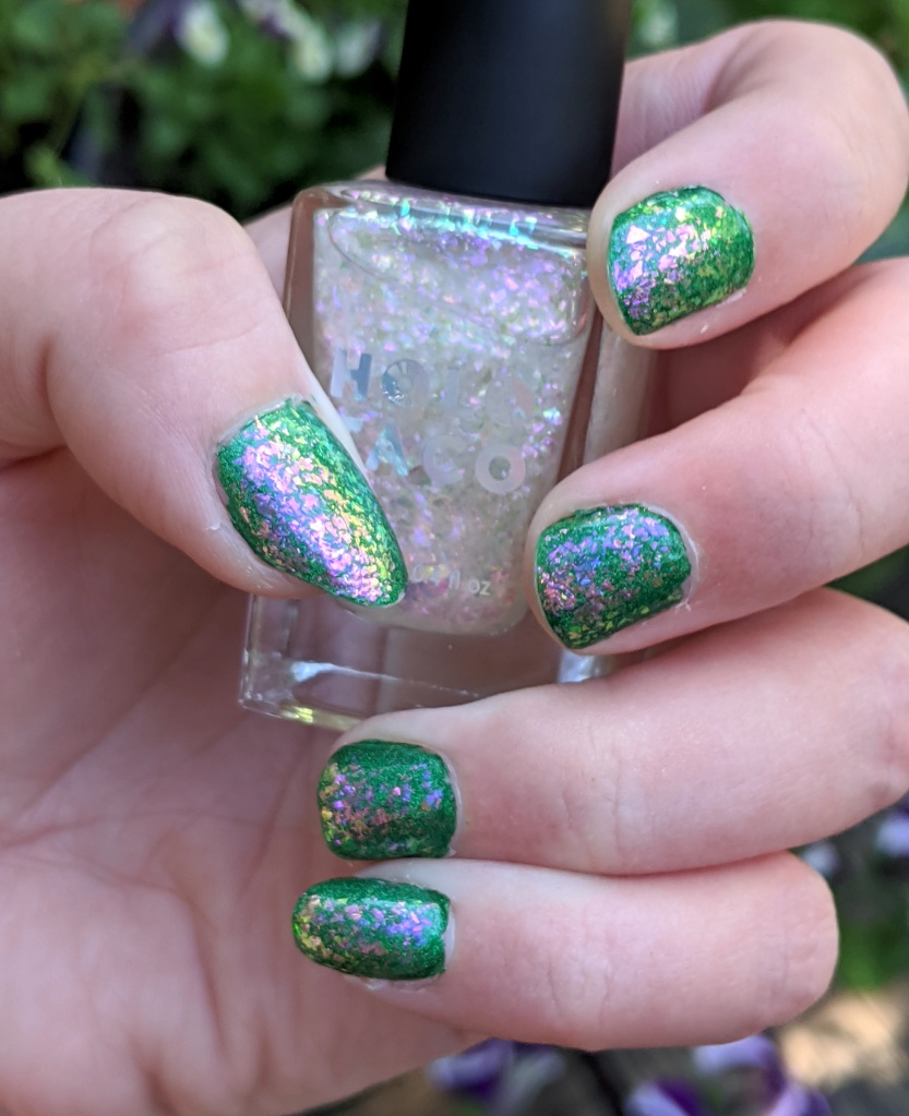 My right hand painted with thick translucent flecks that look pink and green